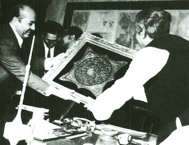 Sheikh Mujibur Rahman presented with a Calligraphy of the Holy Quran by the Egyptian delegates of a trade mission.