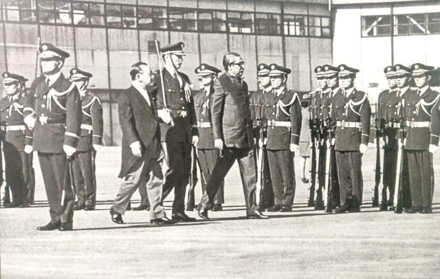 Sheikh Mujibur Rahman receiving the guard of honor on his visit to Japan. Present with him is the Prime Minister of Japan Kakuei Tanaka in October 1973).